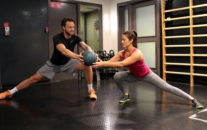 Side lunge with ball transfer